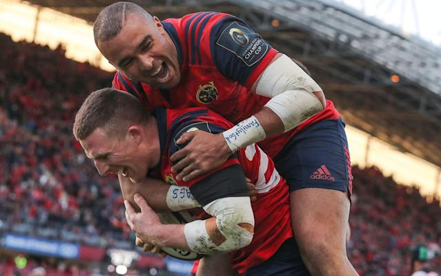 Andrew Conway celebrates his try with Simon Zebo - Rex Features