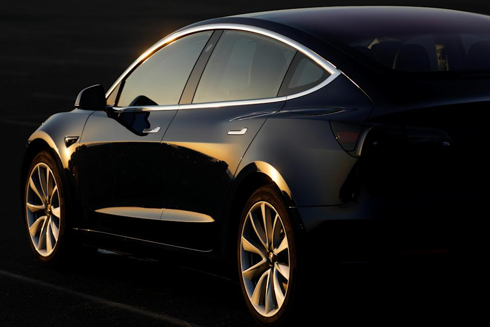 A 2018 Tesla Model 3 electric vehicle is shown in this photo illustration taken in Cardiff, California, U.S., June 1, 2018. Picture taken June 1, 2018.     REUTERS/Mike Blake
