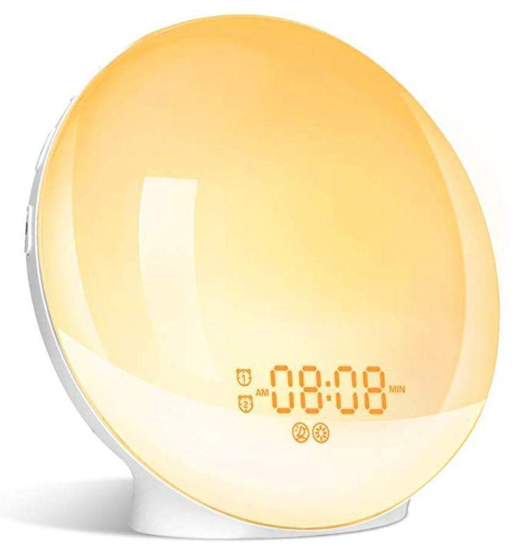 """Most people have trouble getting up in the morning, but this Wake Up Light is supposed to simulate sunrise by gradually changing colour and brightness. So rather than being startled every morning with a heart-attack inducing alarm, you can wake up gently, and calmly.&nbsp;<a href=""""https://www.amazon.ca/GRDE-Colored-Simulation-settable-Functions/dp/B07KZQZ7GS/ref=zg_mg_electronics_36?_encoding=UTF8&amp;psc=1&amp;refRID=K6G1XJP6ET1J350Q980J"""" target=""""_blank"""" rel=""""noopener noreferrer"""">Get it for $49.99 at Amazon.ca.</a>"""