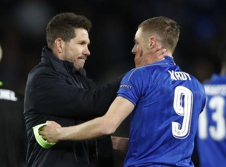 Leicester City's Jamie Vardy with Atletico Madrid coach Diego Simeone at the end of the match