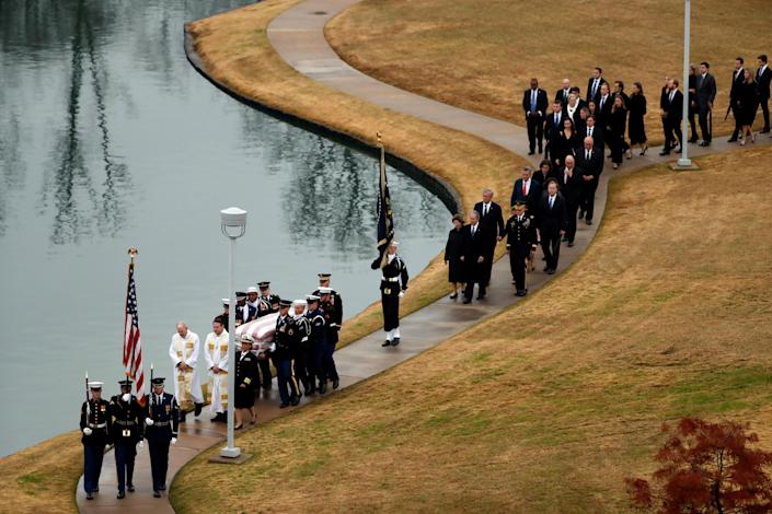 The flag-draped casket of former President George H.W. Bush is carried by a joint services military honor guard followed by family members at the George H.W. Bush Presidential Library and Museum Thursday, Dec. 6, 2018, in College Station, Texas. (Photo: Jeff Roberson/Pool via Reuters)
