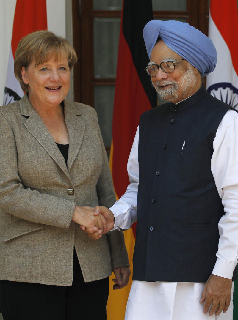 Indian Prime Minister Manmohan Singh, right, greets German Chancellor Angela Merkel prior to a meeting in New Delhi, India, Tuesday, May 31, 2011. German Chancellor Angela Merkel is India for talks with the country's prime minister on trade and defense. She is expected to push a multibillion dollar deal to supply 126 fighter jets to India. (AP Photo/Saurabh Das)