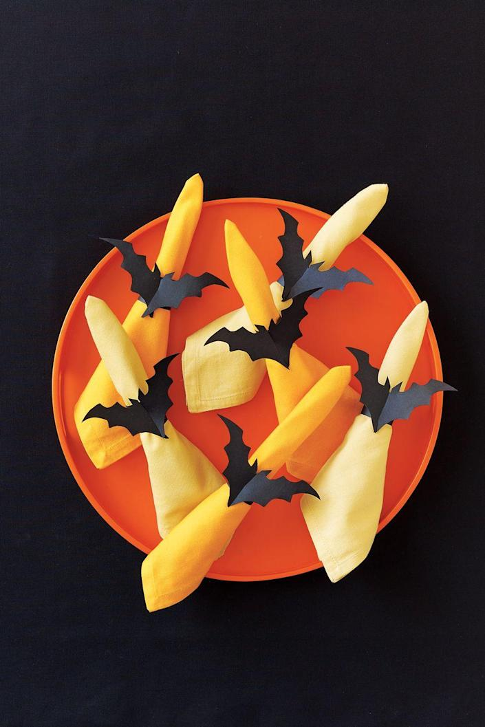 """<p>These bat-shaped napkin rings are sure to add flair to any silverware set. </p><p><strong><em><a href=""""https://www.womansday.com/home/crafts-projects/how-to/a5996/halloween-craft-how-to-bat-napkin-rings-123823/"""" rel=""""nofollow noopener"""" target=""""_blank"""" data-ylk=""""slk:Get the Bat Napkin Rings tutorial"""" class=""""link rapid-noclick-resp"""">Get the Bat Napkin Rings tutorial</a>. </em></strong></p><p><a class=""""link rapid-noclick-resp"""" href=""""https://www.amazon.com/Artists-Tracing-Sheets-Translucent-Sketching-Lightweight/dp/B0788K7D3K?tag=syn-yahoo-20&ascsubtag=%5Bartid%7C10070.g.2488%5Bsrc%7Cyahoo-us"""" rel=""""nofollow noopener"""" target=""""_blank"""" data-ylk=""""slk:SHOP TRACING PAPER""""> SHOP TRACING PAPER</a></p>"""