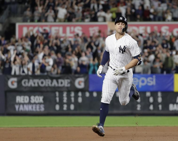 New York Yankees' Giancarlo Stanton runs the bases after hitting a grand slam during the fourth inning of a baseball game against the Boston Red Sox on Thursday, Sept. 20, 2018, in New York. (AP Photo/Frank Franklin II)