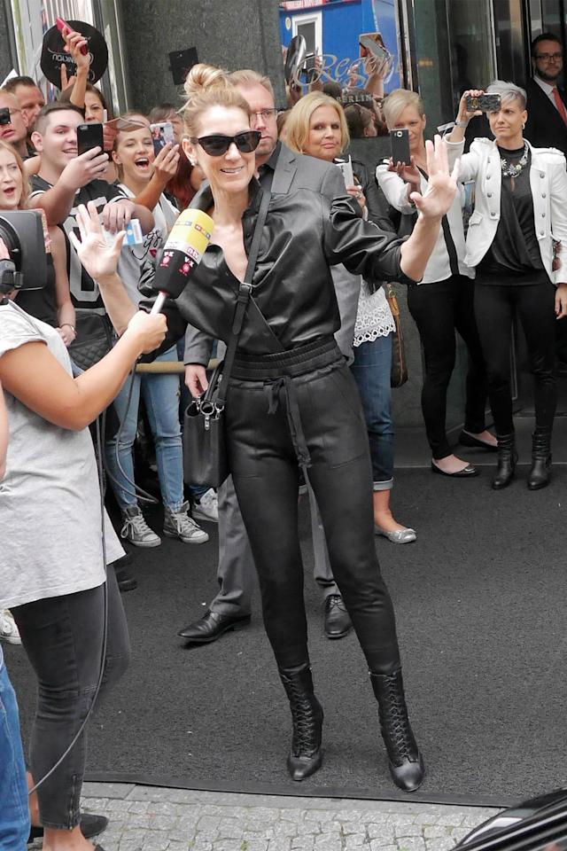 <p>In a Saint Laurent leather blouse, joggers, boots and black cat-eye sunglasses while out in Berlin. </p>