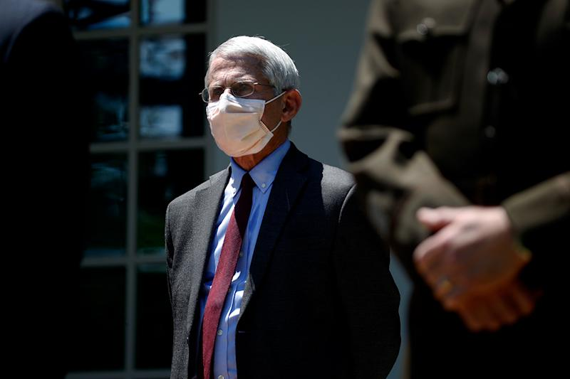 Dr. Anthony Fauci listens as President Donald Trump speaks about the coronavirus in the Rose Garden of the White House, Friday, May 15, 2020, in Washington. (AP Photo/Alex Brandon)