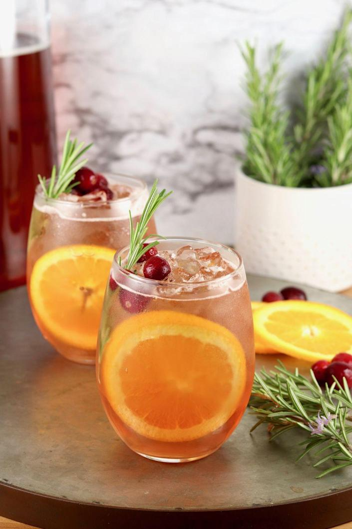 """<p>A little sprig of rosemary is always the perfect Christmas garnish. Enjoy this punch before, during, or after dinner.</p><p><strong>Get the recipe at <a href=""""https://www.missinthekitchen.com/winter-moscato-punch/"""" rel=""""nofollow noopener"""" target=""""_blank"""" data-ylk=""""slk:Miss in the Kitchen"""" class=""""link rapid-noclick-resp"""">Miss in the Kitchen</a>.</strong> </p>"""