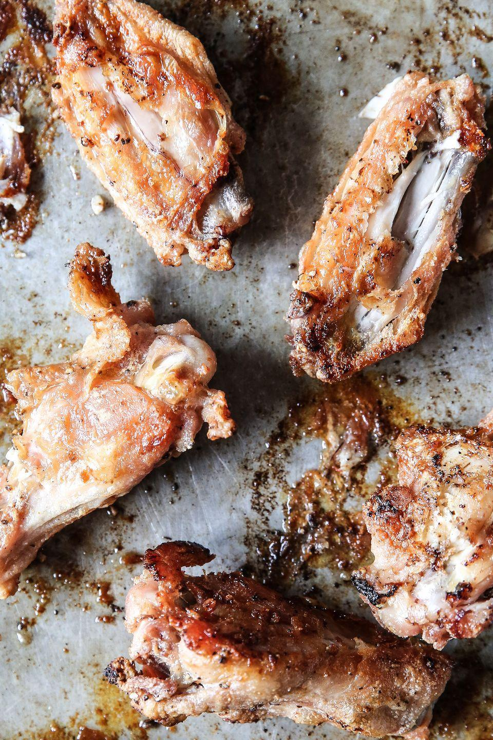 """<p>It's the easiest way to make wings. Bar none.</p><p>Get the recipe from <a href=""""/cooking/recipe-ideas/recipes/a53411/easy-oven-baked-chicken-wings/"""" data-ylk=""""slk:Delish"""" class=""""link rapid-noclick-resp"""">Delish</a>.</p>"""