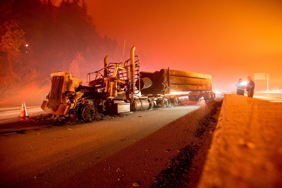 An abandoned smoldering truck after the Delta Fire tore through the area north of Redding, California and jumped the interstate on 5 September 2018 (AFP via Getty Images)