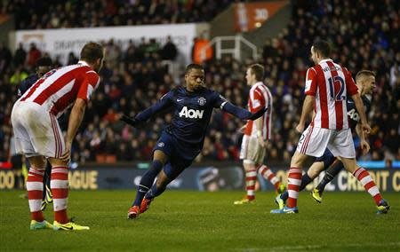Manchester United's Patrice Evra (C) celebrates scoring during their English League Cup quarter-final soccer match against Stoke City at the Britannia stadium in Stoke-on-Trent, central England, December 18, 2013. REUTERS/Darren Staples