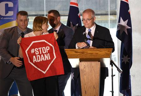 A Stop Adani protestor is removed from the stage where Australian Prime Minister Scott Morrison was making a speech at the Valley Chamber of Commerce business luncheon in Brisbane, Australia, April 8, 2019. Picture taken April 8, 2019. AAP Image/Dave Hunt/via REUTERS