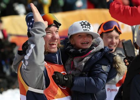 Freestyle Skiing - Pyeongchang 2018 Winter Olympics - Men's Ski Halfpipe Finals - Phoenix Snow Park - Pyeongchang, South Korea - February 22, 2018 - David Wise of the U.S. celebrates with his son Malachi after winning the event. REUTERS/Mike Blake