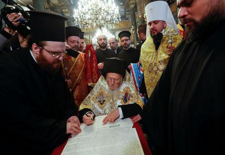 Ecumenical Patriarch Bartholomew and Metropolitan Epifaniy, head of the Orthodox Church of Ukraine, attend a signing ceremony marking the new Ukrainian Orthodox church's independence, at St. George's Cathedral, the seat of the Ecumenical Patriarchate, in Istanbul, Turkey January 5, 2019. REUTERS/Murad Sezer