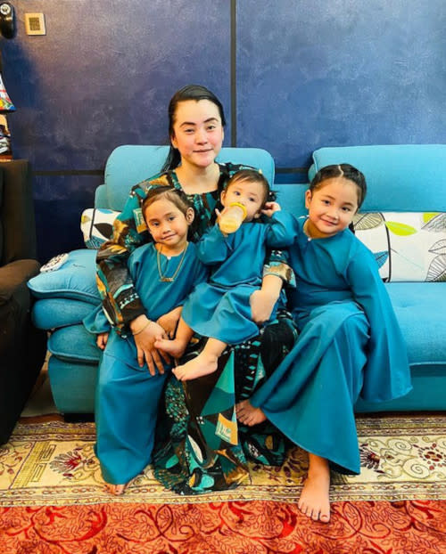 Almy with her three adorable daughters