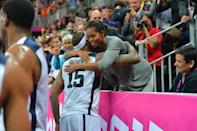 Carmelo Anthony #15 of the USA Mens Senior National team hugs The First Lady Michelle Obama after defeating France 98-71 at the Olympic Park Basketball Arena during the London Olympic Games on July 29, 2012 in London, England. NOTE TO USER: User expressly acknowledges and agrees that, by downloading and/or using this Photograph, user is consenting to the terms and conditions of the Getty Images License Agreement. Mandatory Copyright Notice: Copyright 2012 NBAE (Photo by Jesse D. Garrabrant/NBAE via Getty Images)