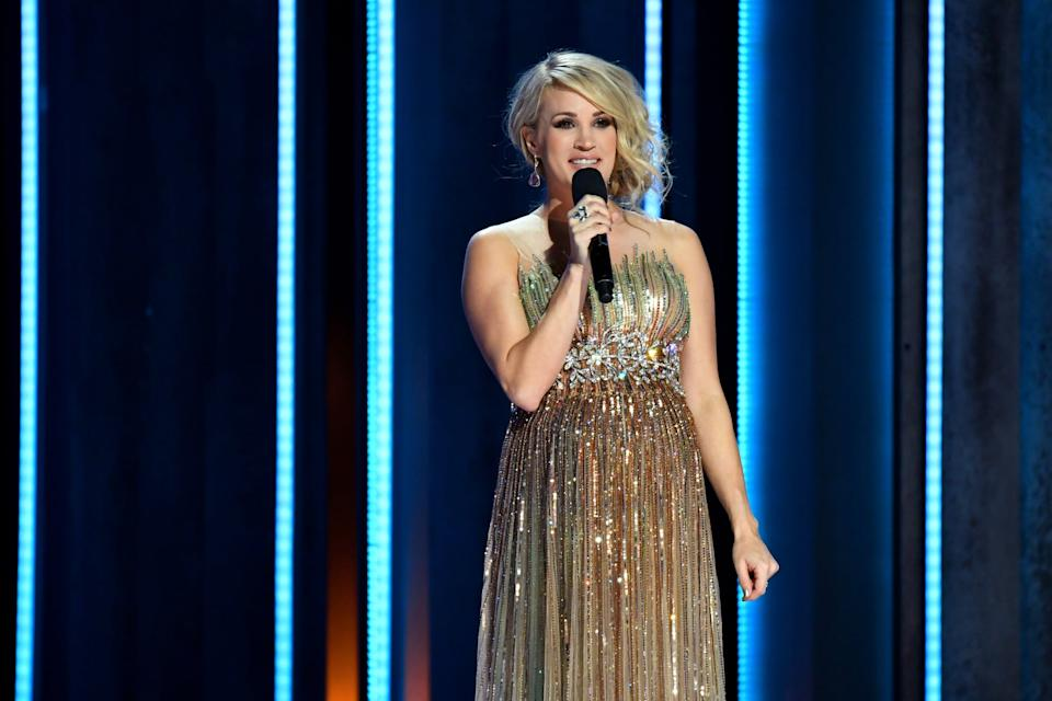 NASHVILLE, TN - NOVEMBER 14:  (FOR EDITORIAL USE ONLY) Carrie Underwood speaks onstage during the 52nd annual CMA Awards at the Bridgestone Arena on November 14, 2018 in Nashville, Tennessee.  (Photo by Erika Goldring/WireImage,)