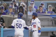 Los Angeles Dodgers' Mookie Betts (50) celebrates his solo home run with Justin Turner (10) against the Seattle Mariners during the first inning of a baseball game Monday, Aug. 17, 2020, in Los Angeles. (AP Photo/Marcio Jose Sanchez)