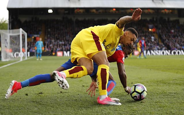 <p>Burnley's Andre Gray in action with Crystal Palace's Wilfried Zaha </p>
