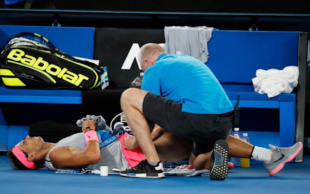 "After being forced to retire from a grand-slam match for only the second time in his illustrious career, Rafael Nadal redoubled his calls last night for the players' health to be better protected. At the time of his withdrawal, Nadal was trailing Marin Cilic 0-2 in the deciding set of their quarter-final. Over the previous half-hour, he had undergone treatment on what appeared to be a groin or upper thigh injury, but it failed to improve his movement discernibly. In fact, he was limping more heavily with each passing game, and eventually had no alternative but to shake hands. Afterwards, Nadal was vague about the exact nature of the problem, saying that he could not be sure until he undergoes scans. But he continued to complain that tennis's authorities are showing insufficient regard for players' bodies. It is a point he has made many times over the years, most recently on the eve of this tournament. ""Somebody who is running the tour should think little bit about what's going on,"" said Nadal. ""Too many people getting injured. I don't know if they have to think a little bit about the health of the players. Not for now that we are playing, but there is life after tennis. I don't know if we keep playing on these very, very hard surfaces what's going to happen in the future with our lives."" Nadal had started the match in barnstorming fashion, striking no fewer than 17 clean winners in the opening set. Had he continued at this breakneck pace, he might have made it through in double-quick time, maintaining the possibility of another grand-slam final against Roger Federer. Nadal signs off in Melbourne after suffering with a hip complaint during the fourth set Credit: AFP Instead Nadal's intensity dropped, allowing Cilic – who was serving bombs throughout – to level at one set apiece. And this proved to be crucial, for it was in the fourth set that something tore near the top of his right leg. ""I start to feel the muscle little bit tired in the third [set],"" said Nadal. ""But playing normal, no limitation. Then in the fourth at one movement, one drop-shot I think, I felt something. At that moment I thought something happened, but I didn't realise how bad. ""I am a positive person,"" added Nadal, whose only previous retirement at a major had come against Andy Murray in the quarter-final of this event in 2010. ""But today is an opportunity lost to be in the semi-finals of a grand slam and fight for an important title for me, no? Nadal was grimacing between points Credit: AFP ""In this tournament already happened a couple of times in my life, so it's really tough to accept. It's a negative thing, but I don't going to complain because happened to me more than others. But who knows, if I didn't have all these injuries..."" We can probably assume that, without the chronic handicaps of vulnerable knees and a misshapen bone in his foot, Nadal would lead the grand-slam winners' table with more than 20 titles. As it is, his absence would seem to strengthen Federer's chances of landing a 20th major of his own on Sunday, assuming that Federer can squeeze past Tomas Berdych today. Unfortunate scenes here with the world No.1 Rafael #Nadal retiring hurt in the QF ��@Cilic_Marin progresses through to the SF. #AusOpenpic.twitter.com/IEjPruzvdi— #AusOpen (@AustralianOpen) January 23, 2018 Cilic had hardly been talked about as a potential champion here, but his sheer power – which manifested in a remarkable tally of 83 clean winners – surely played a part in making Nadal's night so miserable. He served 20 aces and swung with a freedom he has rarely achieved since his charge to the 2014 US Open title. Cilic thus progresses to a semi-final against Kyle Edmund, which will bring together two of the fieriest forehands in the game. ""Kyle had amazing run here,"" Cilic said. ""He's also very entertaining to watch. Big hitter, great serve, great forehand. Plays great on the hard courts. ""For me, another good opportunity. Obviously on the paper probably easier to play him than Rafa. But still he [Edmund] deserved a lot to be here at the spot where he is."" 12:21PM Match was evenly balanced before Nadal injury Greg Rusedski in his post-match analysis feels that Cilic was spurred into action when the chair umpire handed him a time violation in the second set as Nadal broke for a 3-2 lead. The Croatian fuming at the telling off won the next four games to level the match. His aggressive approach began to frustrate Nadal long before the Spaniard suffered his injury during the fourth set and should be commended for his positive play throughout. It's a shame Cilic won through this way, but I support Rusedski's thinking that the match was very much in the balance before injury struck. 12:14PM Cilic next for Edmund So Edmund now knows he'll face the No 6 seed in the semi-finals on Thursday morning (UK time). As mentioned earlier, Edmund has lost his sole meeting with the Croatian at the Shanghai Masters last autumn. Nadal, meanwhile, won't lose his world No 1 ranking regardless of the outcome in Melbourne. If Federer defends his title and wins a 20th grand slam title, he'll only be a mere 155 points off his great rival. 12:09PM Cilic speaks ""It was an unbelievable performance from both of us and it's really unfortunate for Rafa. He always gives his best and it's unfortunate for him to end this way. ""I was really paying attention to these first couple of games (in the final set) and trying to keep my intensity up. It was important for me to continue with my own game and not look across the net."" Sad to see @RafaelNadal go out with an injury like that. Did well to fight on through the pain but was clearly in much pain. He hates to retire but the wise long term decision to retire. #AusOpen— Pat Cash (@TheRealPatCash) January 23, 2018 12:04PM Nadal signs off Not the way Cilic would've wanted to win the match with the sight of Nadal hobbling to the net to shake hands and concede defeat. Cilic was pushing Nadal to the limit before the Spaniard's injury and had both been fighting fit it was a tough call on who was going to win through. 12:03PM Nadal 6-3, 3-6, 7-6, 2-6, 0-2 Cilic* Plenty of cheers ring round Rod Laver as Nadal sprints (of sorts) down to his end. Could this be the final game of his tournament? He'll be loathe to retire but he has to think of the long-term implications of staying out there. He still is able to pull out the odd crowd-pleasing winner or two as he saves a couple of break points with two forehand winners. His father is on the phone to someone in his corner. Cilic keeps the pressure on Nadal by forcing him to scamper into the net. The Spaniard does his best to chase down but hasn't the legs. It's a hard watch as Nadal grimaces on the baseline as he prepares to send down another serve in an attempt to save break point No 5. He's got the sympathy vote on Rod Laver as they cheer another break saved. Cilic is watching Nadal between points now. The Croatian has to be mindful of not letting his concentration drop. A swing and strike into the tramlines hands Cilic break point No 6 and he makes it count with a rasping passing winner. Nadal walks over to the chair umpire to shake hands. He just couldn't go on, Cilic has been handed the win. CILIC IS THROUGH TO THE SEMI-FINALS 11:54AM Nadal* 6-3, 3-6, 7-6, 2-6, 0-1 Cilic (*denotes next server) Nadal had another quick rub-down during the end of the last set, trying to get some motion back in his right-hip socket. His movement is clearly impaired and Cilic is looking to rattle through his opening service game. He races to three games points and lands a couple of aces for a comfortable love hold. 11:50AM Nadal 6-3, 3-6, 7-6, 2-6 Cilic* (*denotes next server) Nadal thinks twice about even attempting to get to one service return winner from Cilic as the Spaniard grimaces while going through his service rotation. Cilic keeps knocking on the door, drawing his opponent back but Nadal is doing just enough to stay afloat - for now. Cilic could let this game go and just come out and serve for the set, but it's not his style. And he's right to do so. His persistence pays off as he forces set point. And Cilic levels for the match with another sweeping forehand down the line. We have a decider. CILIC BREAKS TO WIN FOURTH SET. Stats from the fourth set Credit: Australian Open 11:45AM Nadal* 6-3, 3-6, 7-6, 2-5 Cilic (*denotes next server) Cilic has little sympathy for Nadal as he moves the Spaniard from front to back now. Nadal shows little sign of injury as he makes the chase and then turns on his heels to retrieve the long ball. His hot-dog reply is a crowd pleaser but Cilic mops up at the net to stay on track this game. Cilic is well set at two game points but slaps into the net as Nadal grumbles towards his corner. Cilic won't allow Nadal to hang around in the game as he slaps another winner whizzing past his opponent. Nadal will serve to stay in the fourth set. 11:41AM Nadal 6-3, 3-6, 7-6, 2-4 Cilic* (*denotes next server) Nadal pulls up on the opening point. He's struggling big time out there but Nadal very rarely retires. He played with one leg during the Aussie Open final against Stan Wawrinka in 2014. A penny for Kyle Edmund's thoughts right now. The set is racing away from Nadal as he stares down at three break points. Cilic swings and misses at the first two as Nadal gets a couple of first serves in. And Nadal battles well to save a third-straight break point by moving his rival from the depths of the court to the front as Cilic fails to charge down a drop shot. Five straight points later and Nadal drills a forehand winner down the line. Problem, what problem, er? 11:36AM Nadal treated for hip complaint Nadal calls for his trainer as he rubs the top of his right hip. He's handed a couple of tablets and discusses the issue with his trainer. A listen to the on court-mic suggests that Nadal started feeling the problem as he charged down one shot. A three-minute medical later and he's ready to go again. 11:32AM Nadal* 6-3, 3-6, 7-6, 1-4 Cilic (*denotes next server) Great hitting from both men again as Nadal works his rival from side-to-side before engineering enough room to pull the trigger. The quality in this match has moved up a couple of gears now as Cilic makes a superb pick up at the net and executes a sublime drop shot. He backs it up by pulling off a backhand winner across court which is too good for Nadal. Cilic still believes he can win this contest. And if he continues to play in the same vein, you have to say he has more than a chance of getting back into this one. 11:29AM Nadal 6-3, 3-6, 7-6, 1-3 Cilic* (*denotes next server) What a point. The pair haven't engaged in two many baseline duels, Cilic doesn't want to get lulled into them and you can see why as Cilic blinks first at the end of a 23-shot slug-fest. Cilic doesn't know when he's beaten. He's been able to carve out some great angles today and one forehand has Nadal stretching to make his reply. He sends over a backhand but it's long. Cilic sets up break point, and this time he makes the most of his opportunity, rolling his wrist over another forehand winner down the line. CILIC BREAKS. 11:22AM Nadal* 6-3, 3-6, 7-6, 1-2 Cilic (*denotes next server) Both men have started their service games off strongly at the beginning of the fourth. Nadal keeps the pressure on Cilic by edging back from 30-0 down and 40-15 behind. It's paying off. Cilic slaps a forehand into the middle for deuce. He stops Nadal's momentum by smashing an overhead out wide but then Cilic's seventh double fault of the match hands Nadal another free point. Luckily for the Croatian he's been so good at the net together as he mobs up well to dispatch a volley which lands deep, but well in still. 11:17AM Nadal 6-3, 3-6, 7-6, 1-1 Cilic* (*denotes next server) Oor er. What a reaction from Cilic who flashes a service return right past Nadal for 0-30. The clock ticks past the three-hour mark as Nadal hangs in to reel in Cilic. The Croatian isn't able to get enough on a couple of well-placed first serves and Nadal is on the board this set. Credit: AFP 11:13AM Nadal* 6-3, 3-6, 7-6, 0-1 Cilic (*denotes next server) Physically Cilic looks well set to challenge Nadal but mentally how will he hold up after losing that vital breaker? The early signs are good. Back-to-back aces settle the Croatian. 11:08AM Nadal 6-3, 3-6, 7-6 Cilic TIEBREAK CONT. What a return from Nadal out wide and Cilic can't make the pick up at the net (4-3). A baby is crying in the stands. It's unsettling for Nadal who shapes to serve. He reels away and then goes through his rhythm again. He offers an arm to his rival in way of apology for the delay. No worries says Cilic as he fires down a thunderous forehand winner for four-all. But Cilic can't repeat the feat on his backhand wing and Nadal edges back infront (5-4). Cilic has Nadal put on his sprinting boots chasing down a drop shot but without success (5-5) and after setting himself up well with some booming forehands, Cilic over-eggs one to hand Nadal set point (6-5). That's gonna hurt for Cilic. Nadal does take the third set with an overhead smash into the advantage court. He's fist-pumping a plenty. The crowd are on their feet. What a tie-break. NADAL WINS THIRD SET TIE-BREAK. Credit: AFP 11:02AM Nadal 6-3, 3-6, 6-6 Cilic TIEBREAK Nadal up and running with a solid first serve (1-0) and then has a mini-break when Cilic strikes a backhand into the net (2-0). Cilic keeps his cool to send an out-swinging first serve which is too good for Nadal to control (2-1). And a flashing backhand winner draws the Croatian level (2-2). What a pass from the big man! Another backhand winner moves Cilic in front for the first time in the breaker (2-3). He really looks like he has the self-belief to carry him through. But Nadal heads to the change of ends level when Cilic strikes long (3-3). Stats you need: Cilic bidding to be first palindromic #AusOpen champ since Seles 22 years ago.— Ben Rothenberg (@BenRothenberg) January 23, 2018 10:57AM Nadal* 6-3, 3-6, 6-6 Cilic (*denotes next server) Cilic on fire during this service game. He drills a beautiful forehand down the line to bring up three game points. He wraps up a love game. Who are you backing in the breaker? 10:56AM Nadal 6-3, 3-6, 6-5 Cilic* (*denotes next server) Solid serving from Nadal as he lifts his first serve percentage to 87% for this set compared to Cilic's 64%. Only problem has been the Spaniard has won 69% on his first serve while Cilic has won 81%. This set is heading for a tie-break it seems. 10:53AM Nadal* 6-3, 3-6, 5-5 Cilic (*denotes next server) Nadal takes advantage of a second serve, injecting pace into the rally, striking a winner and increasing the noise levels in the stands. The stuttering nature of this match hasn't engaged the spectators on Rod Laver Arena. But now the spectators have something to cheer about. Nadal has a set point chance. Cilic is all over rival from the net. Nadal is hanging in for dear life at the baseline, swatting a couple of returns back before Cilic puts the nail in the coffin. Well saved Marin. The Croatian manages to steer his way of of danger. We remain on serve. 10:45AM Nadal 6-3, 3-6, 5-4 Cilic* (*denotes next server) Steady does it for Cilic who unsettles Nadal's flow again. The Croatian can't get up and under a backhand to inflict further pain when well placed at 30-all and a wide forehand into the tramlines ensures the third set remains on serve. It remains nip and tuck out there. 10:41AM Nadal* 6-3, 3-6, 4-4 Cilic (*denotes next server) Nadal tries a different tactic on the Cilic serve, shifting his body one way in anticipation of an out-swinging serve only to watch the Croatian pass him down the middle. Cilic does finally go for the out-swinging first serve which brings up a comfortable hold. 10:36AM Nadal 6-3, 3-6, 4-3 Cilic* (*denotes next server) Cilic has shown great defensive work and superb court movement to frustrate Cilic in the second and third sets. It's not going all Nadal's way and the Spaniard is having to change his approach to try and penetrate Cilic's rearguard action. At least the world no 1's service game is back on song. But from a game-winning position, he misses a regulation volley from close quarters. He looks agonishingly to the sky. Cilic jumps on the error by flashing a forehand winner down the line during the next point for deuce. And when he steps in to flick a backhand winner down the line, Nadal will be replying that missed volley over and over in his head. Nadal saves the break point with a timely first serve but then struggles to make a pick up out wide when Cilic sends his rival out wide to bring up break point No 2. Clever play from Nadal as he rushes the net to punch a volley into the advantage court. He didn't have any problems there. And he's given a let off when a Cilic backhand strikes the tape but lands in his half. Cilic isn't to be overawed by his opponent as he forces a fourth deuce but he can't execute a drop shot and now it's Nadal being able to breath a sigh of relief. That was a mighty let-off for the world No 1. 10:28AM Nadal* 6-3, 3-6, 3-3 Cilic (*denotes next server) The big-serving Croatian is motoring now with his fifth ace in his last seven points. Nadal is struggling to read a Cilic first serve but takes advantage of a slower second serve to draw an error from his opponent to get on the board. It's only a consolation for the Spaniard. 10:24AM Nadal 6-3, 3-6, 3-2 Cilic* (*denotes next server) Nadal's service rhythm has been restored with a hold to love for the first time in the third set. This match remains too close to call. 10:20AM Nadal* 6-3, 3-6, 2-2 Cilic (*denotes next server) Two hours on court and Cilic is brimming with confidence and self-belief. It takes a slight knock when he sends an overhead long and then from a position of control and authority the Croatian sends down a double to allow Nadal to hang around at deuce. Cilic is back on the frontfoot with his 10th ace and then secures the hold with an unreturnable first serve. 10:14AM Nadal 6-3, 3-6, 2-1 Cilic* (*denotes next server) Cilic is striking the ball so well right now, leaving Nadal all at sea on the baseline. It's a tactic that Cilic very rarely is able to execute well against the Spaniard but he mixes it up by advancing to the net where possible and dispatches a volley to leave Nadal flustered. Oor e. The Spaniard is well and truly rattled as he drags a forehand wide to hand Cilic another break point. Nadal saves the danger with some deep groundstrokes which forces his opponent to strike long. Nadal tries to again to inject some life and noise from the crowd by pumping his fist. It's done the trick this game as he edges back in front for the set. #Nadal seems to have lost his rhythm. Strange errors creeping into his game. Possibly because #Cilic is finding his forehand early and controlling points. #AusOpen— Pat Cash (@TheRealPatCash) January 23, 2018 10:08AM Nadal* 6-3, 3-6, 1-1 Cilic (*denotes next server) Cilic crucially slaps a venomous volley into the corner to put the brakes on Nadal's charge at 15-30. The Croatian steers his way through another sticky patch to come through the other side with three straight points. Great composure and a cool head from the sixth seed. 10:03AM Nadal 6-3, 3-6, 1-0 Cilic* (*denotes next server) Cilic won 9/11 shots at the net during the second set and it's an aggressive approach he needs to maintain at the start of the third to keep the heat on. Nadal's energy and confidence levels are restored as he chases down a shot off the tape to set up two game points. That got the crowd involved and the Spaniard loves to feed off their vibrancy. It helps him over the line here and stops Cilic's four-game winning streak. 9:55AM Nadal* 6-3, 3-6 Cilic (*denotes next server) It's slightly flat on Rod Laver Arena as spectators are taken aback by how this set has swung away from Nadal. Cilic isn't showing signs of tightening up either as he rushes to two set points courtesy of ace No 7. Cilic puffs out his cheeks after missing the first one. But an ace draws him level for the match. Game on. CILIC WINS SECOND SET. Huge turn around in this match! #Cilic takes the 2nd set and levels the match after being down a break. Relaxed yet aggressive tennis from the big man has made all the difference. #Nadal has a fight on his hands now! #AusOpen— Pat Cash (@TheRealPatCash) January 23, 2018 9:51AM Nadal 6-3, 3-5 Cilic* (*denotes next server) Nadal looks to be heading for a comfortable hold before Cilic leaps on a couple of second serves to send down two winners on either flank for 30-all. Nadal is all over a short reply from Cilic to quell the flow. The Croatian is unsettling Nadal's rhythm here and starting to cause the Spaniard a few more problems. He has another break point here to give him breathing space in the set. And he does, and how. A fantastic forehand winner is struck at such an acute angle that Nadal gets his racket head on but can only steer into the net. CILIC BREAKS. 9:44AM Nadal* 6-3, 3-4 Cilic (*denotes next server) After a break apiece, normal service resumes as Cilic rattles through a love hold with back-to-back aces. 9:42AM Nadal 6-3, 3-3 Cilic* (*denotes next server) McEnroe feels Cilic was harshly treated in that last service game by being handed a time violation. ""This guy is hard enough to beat without throwing that into the mix,"" he says. He has a point, but it has felt that Cilic has taken over Djokovic's mantle for most balls bounced between service rotations. Back to the action and the Croatian has a chance to break back instantly. Nadal reels Cilic is from 0-30 down but then stops a three-point rot with a winner into the corner. Nadal's game level takes another dip as a double fault after a second deuce hand Cilic another break point. But again the Croatian can't capitalise. Thankfully for him, another bite at the cherry is round the corner. This time he takes it with a service return forehand winner. We're back on serve this set. CILIC BREAKS. Game ��@cilic_marin breaks back! 3-3 early in the second set.#AusOpenpic.twitter.com/ixaE45RUzc— #AusOpen (@AustralianOpen) January 23, 2018 9:33AM Nadal* 6-3, 3-2 Cilic (*denotes next server) Nadal injects some pace during a lengthy rally to throw Cilic off his stride. It edges the Spaniard to 15-30. Nadal anticipates well on the next point as he mops up a volley from Cilic to strike a winner down the line for two break points. Cilic is handed a time violation against Nadal of all people as he takes an age going through his next service rhythm. And it throws his concentration completely. He sends down a double to hand Nadal the crucial break in the second. NADAL BREAKS. Cilic was handed a time violation in the second set Credit: Reuters 9:28AM Nadal 6-3, 2-2 Cilic* (*denotes next server) Nadal drops his first point off his serve this set when Cilic steps in court to smash an overhead out of the world No 1's reach. Cilic clenches his fist at rattling another forehand winner zipping past Nadal for 30-all and then has a break point when Nadal dumps a regulation forehand into the middle. It's only the second break point Cilic has earned this match. He couldn't take that one and is yet to punish Nadal as he loops a reply wide. Nadal backs up solid play at the net with good movement from the baseline during the next point to force Cilic into an error. Nadal holds. 9:21AM Nadal* 6-3, 1-2 Cilic (*denotes next server) Nadal has a chance early doors of a break when he crucially steps in to dispatch a backhand winner across court for his first break of this set. Cilic mops up the danger, patrolling the net to smash an overhead winner and then turns the game in his favour with an ace down the middle. He sustains the pressure on Nadal, forcing the Spaniard to go long and retreats to his chair with a spring in his step. FUN FACT! ��@RafaelNadal doesn't hand his towel back to the #VegemiteBallkids until he walks past the @Melbourne sign. Every. Single. Time. #AusOpenpic.twitter.com/nhztbp08g4— #AusOpen (@AustralianOpen) January 23, 2018 9:18AM Nadal 6-3, 1-1 Cilic* (*denotes next server) Nadal serving well, mixing up his play and races to a love game. 9:13AM Nadal* 6-3, 0-1 Cilic (*denotes next server) Cilic recovers from dropping that first set as a well-taken backhand volley assists his progress to two game points. A commanding forehand into the corner moves the sixth seed ahead in the second set. 9:08AM Nadal 6-3 Cilic* (*denotes next server) Cilic shows great defensive play, forcing Nadal into one more shot and his persistence pays off as the Spaniard slaps one groundstroke into the tramlines. Nadal keeps the next rally short and to the point, drilling a backhand back across Cilic which the Croatian acknowledges in his own way was too good. The No 6 seed makes Nadal fight for the set, flashing a service return winner back across Nadal but then watches on as Nadal flicks his own winner deep into the corner to bring up set point. Cilic keeps pushing hard, striking another winner as the quality in this match continues to grow. An ace down the T allows Nadal of a second set point but Cilic again responds with a punched winner, this time off the backhand wing. Nadal finally gets the first set under his belt when he engineers enough room from a serve out wide to deliver a winner down the line after 54 minutes of play. NADAL TAKES FIRST SET. Credit: Reuters 9:00AM Nadal* 5-3 Cilic (*denotes next server) Good opening here for Nadal as Cilic shanks a forehand to hand the Spaniard a mini-break at 0-30. Nadal makes it three break points by stepping into a short ball and flicking a backhand winner down the line. Now he needs to make these points count. Cilic saves the first with an ace. But he strikes wide with his next forehand to hand Nadal the break. NADAL BREAKS. 8:56AM Nadal 4-3 Cilic* (*denotes next server) Pressure now on Nadal's serve now as Cilic draws the error to reel the Spaniard to 30-all. Nadal crucially wins the next point but then a double fault continues a below-par period to this contest. A forehand error from Nadal gifts Cilic a break point but he saves it in style with an ace down the T. He enjoyed that one. A solid first serve out wide swings the game in his favour but Cilic leaps on a Nadal return that clips the tape to hang around. Nadal takes his chances at the net and it pays off during the next point. He spins and pumps his fist as he successfully negotiations his own way out of a brief sticky patch. 8:48AM Nadal* 3-3 Cilic (*denotes next server) Nadal lines up again around 15 yards behind the baseline as he settles down for a Cilic first serve. He takes advantage of a second serve, working enough space to drill a forehand winner down the line but then looks on as a Cilic serve-volley brings him level. The Spaniard stands back for a Cilic serve this time and the Croatian takes control of the point before floating a forehand wide. Nadal continues to take his chance from behind the baseline, but Cilic has him scampering out wide with a forehand pinged to the corner. Nadal berates himself but is able to stay in the game when Cilic drags another groundstroke wide. The Croatian struggling to close out the game and hands Nadal a gift of a break point with his first double fault of the match. Cilic composes himself, sends down a strong and deep first serve which is too good but then hands back the advantage to Nadal with a sloppy ground stroke. This time Nadal is forced out wide and can't lift his backhand over the net. Nadal sets up break point No 3 with a flick of his left-wrist to send a service return whizzing past Cilic. But again, he can't back up his advantage and loops the next return long much to his annoyance. After seven deuces and after saving five break points, Cilic finally strings two points together for a crucial hold. 8:33AM Nadal 3-2 Cilic* (*denotes next server) The first lengthy duel of the match goes Cilic's way when Nadal sends one forehand long. The Spaniard makes up it on the next point, striking a winner down the line while leaning backwards. A trusty out-swinging first serve sets Nadal up to dispatch another winner for two game points. He misses the first but a solid first serve gets him over the line. .@RafaelNadal has not lost to a Top 10 seed at a Grand Slam since falling to No.1 seed Djokovic in the quarterfinals at 2015 Roland-Garros. #AusOpenpic.twitter.com/7Qu2uWArIp— #AusOpen (@AustralianOpen) January 23, 2018 8:29AM Nadal* 2-2 Cilic (*denotes next server) The outswinging ace comes up trumps for Cilic now but then the Croatian is over-zealous with his next stroke play as he tightens up hitting through a forehand. Another out-swinging first serve allows Cilic enough room to send a backhand winner into the opposite corner but Nadal reels in his opponent again by rushing the net and smashing a volley home. Classy play from Cilic at a crucial moment at 30-all as the sixth seed floats a perfectly-placed backhand on the line and out of Nadal's reach. An unforced error allows Nadal to hang around but an overhead backhand winner and ace gives Cilic breathing space. 8:23AM Nadal 2-1 Cilic* (*denotes next server) Boom. Nadal sends down his first ace of the match out wide. Cilic gets a racket head on the next outswinging first serve but can't get it back but then shows good court movement to charge down a drop shot to deliver a winner. That's the first point won off either man's serve so far. Two forehand winners down the line ensure Nadal doesn't allow Cilic a sniff of another point. 8:19AM Nadal* 1-1 Cilic (*denotes next server) Cilic opens up with an outswinging first serve which forces Nadal well behind the baseline. He follows it with a zipping forehand winnner across court and secures his own love game when Nadal can't control a couple of serves. Staff and I have just noticed Nadal is standing in Margaret Court Arena when receiving serve. Deduct point please #AusOpen— Not Roger Federer (@PseudoFed) January 23, 2018 8:17AM Nadal 1-0 Cilic* (*denotes next server) A sleveless Nadal serves first and is aggressive from the off. Solid serving from the Spaniard and he's up and running with a love game. 8:14AM Goran Ivanisevic on how Cilic can beat Nadal Cilic's former coach offers his words of wisdom: ""He's one of the best players the past couple of years but Rafa is going to be tough for him. ""Rafa is looking strong, hitting the ball well and the only chance for Cilic to win is if he's extra aggressive and he needs to serve well. If he doesn't serve well, there's no chance."" 8:07AM Here come the players Cilic enters the Rod Laver first followed by the world No 1 . Cilic last reached the semi-final in Melbourne back in 2010 while Nadal, of course, was a finalist last time out. It's 1️⃣ v 6️⃣. It's ���� v ����. It's a semifinal at stake. And it's going to be good. Who have you got between @RafaelNadal and @cilic_marin? #AusOpenpic.twitter.com/PeH1axlgwi— #AusOpen (@AustralianOpen) January 23, 2018 7:56AM All hail the first-timers The Aussie Open has been all about first-timers. Not only has Edmund reached a first major semi-final, but in the women's draw, Elise Mertens earlier today booked her place in the last four of a slam in her debut at the season-opening major. Mertens upset fourth-seeded Elina Svitolina 6-4, 6-0 to extend her winning streak to 10 matches. She's also the first Belgian since Kim Clijsters in 2012 to reach the semi-finals in Australia, and knew she had plenty of support at home. Mertens dominated throughout against Svitolina, who also reached her first quarter-final in Australia on a nine-match winning roll after winning the Brisbane International two week ago. Svitolina had won their only previous tour-level match, but had no answers on Rod Laver Arena and later said hip trouble had been bothering her all year. 7:23AM Who will be next for Edmund? So after Kyle Edmund's exceptional win over Grigor Dimitrov early this morning, we will find out in the next few hours or so just who the Briton will take on in Thursday's semi-final. World No 1 Rafael Nadal faces 2014 US Open champion Marin Cilic in the first evening match on Rod Laver Arena for the right to play Edmund. Cilic has lost five of his last six matches against Nadal including one in Melbourne seven years ago when the Spaniard won their fourth-round clash in straight-sets. In fact, Cilic, last year's Wimbledon finalist, has only ever taken one set off his rival put that was back in 2015 on the indoor Basle courts. Cilic has dropped two sets en route to his place in the last eight in Melbourne while Nadal has lost only one. Edmund has played and lost once to Nadal - that meeting coming on clay in Monte Carlo last spring. Similarly, Edmund holds the same record against Cilic. The Croatian proving victorious in the third round of the Shanghai Masters last October."