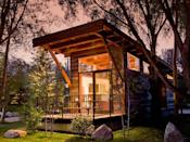 """<p>At first glance, the 400-square-foot Wedge, designed by <a href=""""http://wheelhaus.com/"""" rel=""""nofollow noopener"""" target=""""_blank"""" data-ylk=""""slk:Wheelhaus"""" class=""""link rapid-noclick-resp"""">Wheelhaus</a>, appears to be a tiny luxury cabin but it's actually a mobile Park Model RV. Lofty 17-foot ceilings and a large sliding glass window at the front give an open feel to the rustic yet modern dwelling, which features a bedroom, bathroom, and combined kitchen/living room area. A 100-square-foot deck offers additional entertaining space. The Wedge is one of <a href=""""http://wheelhaus.com/products/"""" rel=""""nofollow noopener"""" target=""""_blank"""" data-ylk=""""slk:six turn-key models"""" class=""""link rapid-noclick-resp"""">six turn-key models</a> offered by Wheelhaus that start from $82,000. Not looking to buy? The Wedge is also available to rent at Fireside Resort at <a href=""""http://www.firesidejacksonhole.com/wyoming-cabin-rentals.htm"""" rel=""""nofollow noopener"""" target=""""_blank"""" data-ylk=""""slk:Jackson Hole Campground"""" class=""""link rapid-noclick-resp"""">Jackson Hole Campground</a>. </p><p><a class=""""link rapid-noclick-resp"""" href=""""http://wheelhaus.com/the-wedge/"""" rel=""""nofollow noopener"""" target=""""_blank"""" data-ylk=""""slk:SEE INSIDE"""">SEE INSIDE</a></p>"""