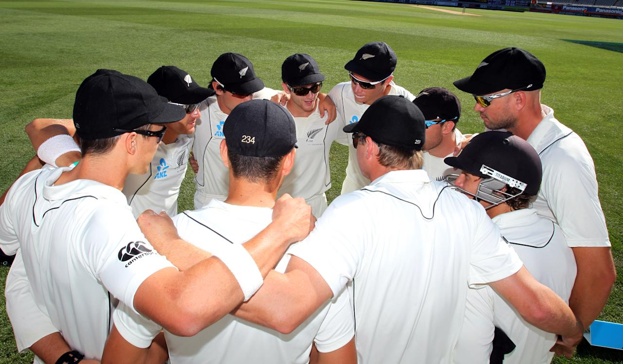 New Zealand have a team huddle during day five of the international cricket Test match between New Zealand and England played at Eden Park in Auckland on March 26, 2013. AFP PHOTO / Michael Bradley        (Photo credit should read MICHAEL BRADLEY/AFP/Getty Images)