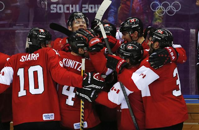 The Canadian bench celebrates their 3-0 win over Sweden in the men's gold medal ice hockey game at the 2014 Winter Olympics, Sunday, Feb. 23, 2014, in Sochi, Russia. (AP Photo/Petr David Josek)