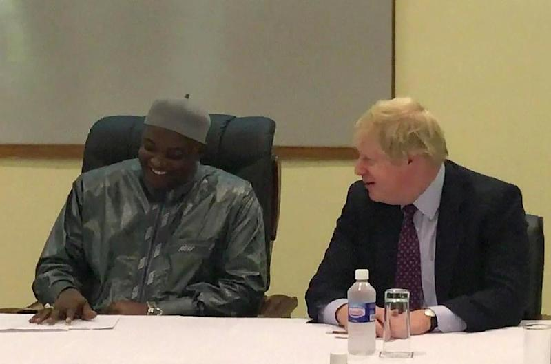 A video grab made from The Block Tv Gambia footage shows British Foreign Secretary Boris Johnson (R) meeting with Gambian President Adama Barrow in Banjul on February 14, 2017 (AFP Photo/STRINGER)