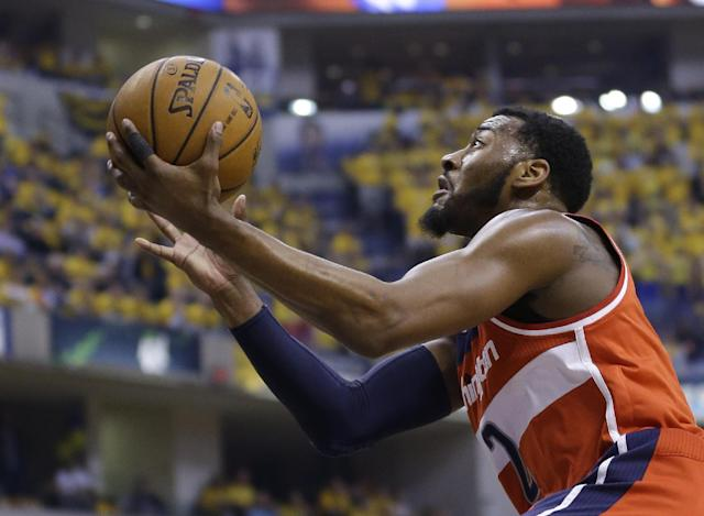 Washington Wizards' John Wall (2) puts up a shot during the first quarter of game 1 of the Eastern Conference semifinal NBA basketball playoff series against the Indiana Pacers in Indianapolis, Monday, May 5, 2014(AP Photo/Michael Conroy)