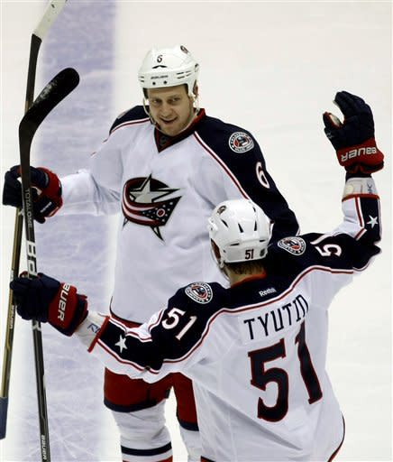 Columbus Blue Jackets defenseman Nikita Nikitin, top, celebrates with Fedor Tyutin after scoring a third period goal during an NHL hockey game on Saturday, March 3, 2012, in Glendale, Ariz. (AP Photo/Rick Scuteri)