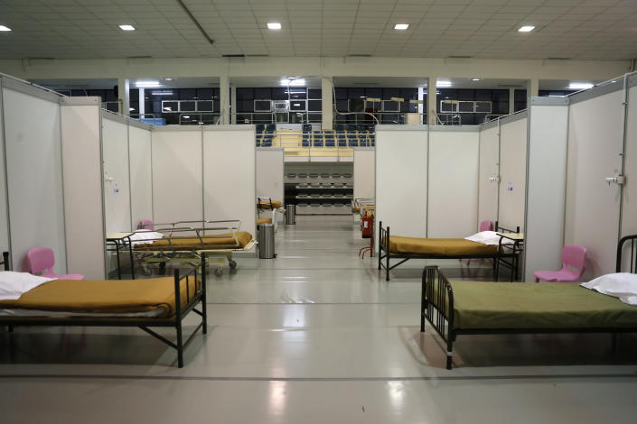 FILE - In this Jan. 20, 2021, file photo, beds are ready to receive the first patients at a field hospital set up in a sports hall in Lisbon. In its fight against COVID-19, Portugal lifted restrictions on gatherings and movements for four days over Christmas so that people could spend the festive season with family and friends. Soon after the holiday, the pandemic quickly got out of hand. (AP Photo/Armando Franca, File)