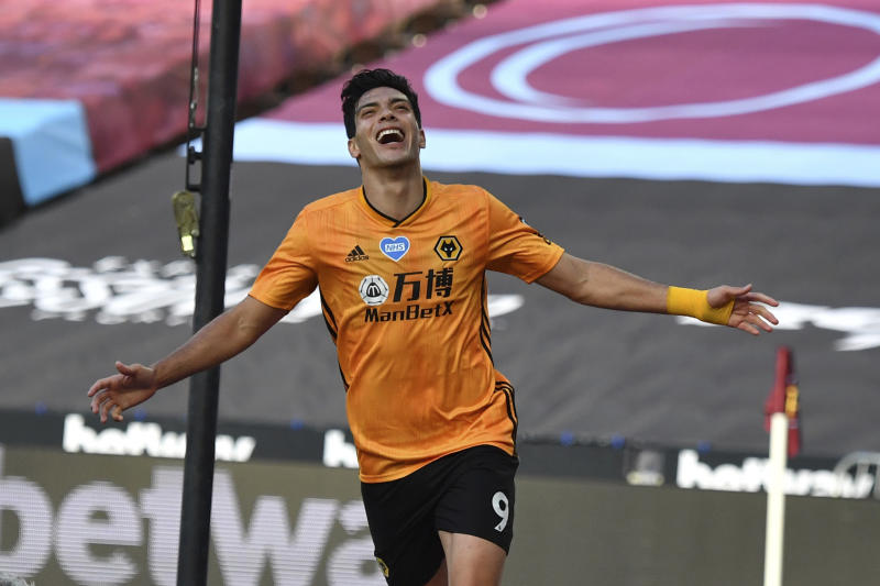 Wolverhampton Wanderers' Raul Jimenez celebrates after scoring his side's first goal during the English Premier League soccer match between West Ham and Wolverhampton at London stadium in London, England, Saturday, June 20, 2020. (Ben Stansall/Pool via AP)