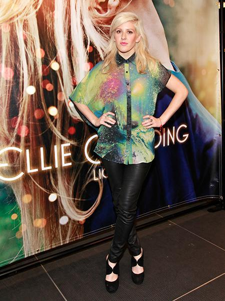 """<div class=""""caption-credit""""> Photo by: Getty Images</div><div class=""""caption-title"""">Ellie Goulding Live at Best Buy last July</div>Proving that her music isn't the only ethereal thing about her, she wore this flowy galaxy-printed top and her favorite leather leggings to perform. By buttoning it to the neck, she was able to show off the contrast collar that is so popular at the moment."""