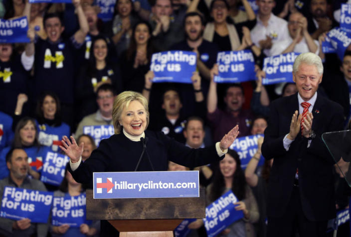 <p>Democratic presidential candidate Hillary Clinton speaks to applause from her husband, former President Bill Clinton, at her presidential primary campaign rally on Feb. 9, 2016, in Hooksett, N.H. (Elise Amendola/AP)</p>