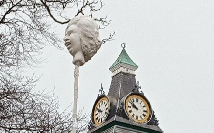 A plaster head was left on a plinth meant for an official statue