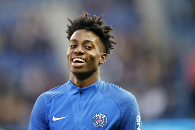 FILE - In this March 14, 2018, file photo, Paris Saint-Germain's Timothy Weah smiles as he trains before the French League One soccer match between PSG and Angers at the Parc des Princes Stadium, in Paris, France. He scored a hat trick against Paraguay last fall in the round of 16 at the Under-17 World Cup, made his U.S. national team debut in March against Paraguay, then scored versus Bolivia on Memorial Day. He's part of the American team playing Saturday, June 9, 2018, against World Cup-bound France in Lyon, facing a Les Bleus roster that includes PSG colleagues Kylian Mbappe, Presnel Kimpembe and Alphonse Areola. (AP Photo/Christophe Ena, File)