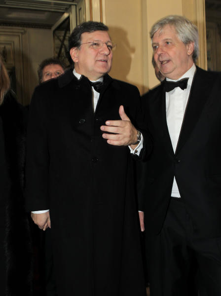 "European Commission President Jose Manuel Barroso, left, shares a word with La Scala opera theater artistic director Stephane Lissner at the opening season gala of the Milan's La Scala opera theater, Italy, Saturday, Dec. 7, 2013. La Scala is concluding its bicentennial celebrations of Giuseppe Verdi's birth with Daniele Gatti conducting ""La Traviata"". (AP Photo/Antonio Calanni)"