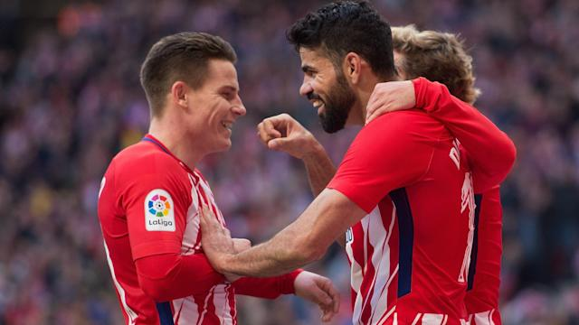 Atletico Madrid maintained pressure on LaLiga leaders Barcelona with a 2-0 defeat of Athletic Bilbao, Kevin Gameiro issuing a rallying call.