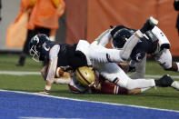 Cincinnati quarterback Desmond Ridder (9) dives over Boston College defensive back Nolan Borgersen (5) for a touchdown during the first half of the Birmingham Bowl NCAA college football game Thursday, Jan. 2, 2020, in Birmingham, Ala. (AP Photo/Butch Dill)