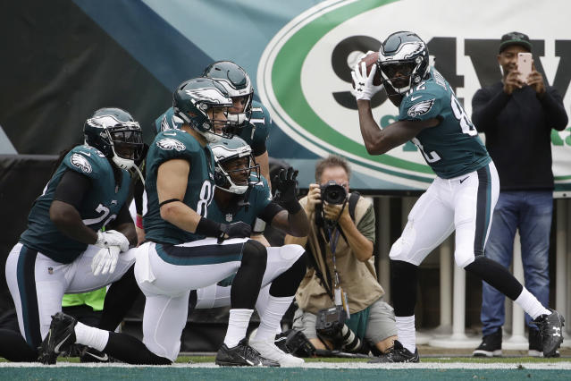 Philadelphia Eagles' Torrey Smith, right, celebrates with teammates after scoring a touchdown during the first half against the Arizona Cardinals. (AP/Matt Rourke)