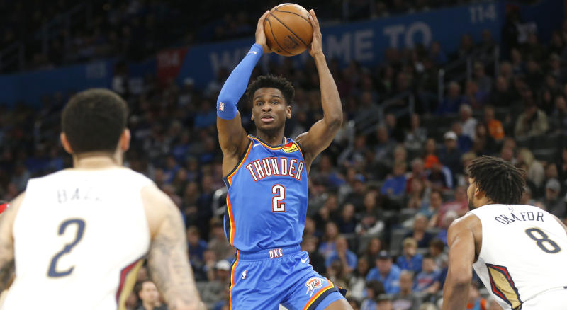OKLAHOMA CITY, OK - NOVEMBER 02: Shai Gilgeous-Alexander #2 of the Oklahoma City Thunder looks off New Orleans Pelicans defenders at Chesapeake Energy Arena on November 2, 2019 in Oklahoma City, Oklahoma. NOTE TO USER: User expressly acknowledges and agrees that, by downloading and/or using this Photograph, user is consenting to the terms and conditions of the Getty Images License Agreement. (Photo by Ron Jenkins/Getty Images)