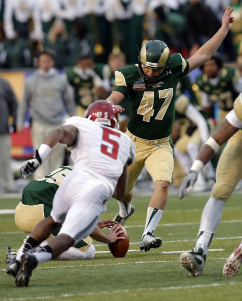 Colorado State kicker Jared Roberts (47) kicks the game winning field goal as Washington State defender Rickey Galvin (5) defends during the second half of the NCAA New Mexico Bowl college football game, Saturday, Dec. 21, 2013, in Albuquerque, N.M. Colorado State won 48-45.(AP Photo/Matt York)