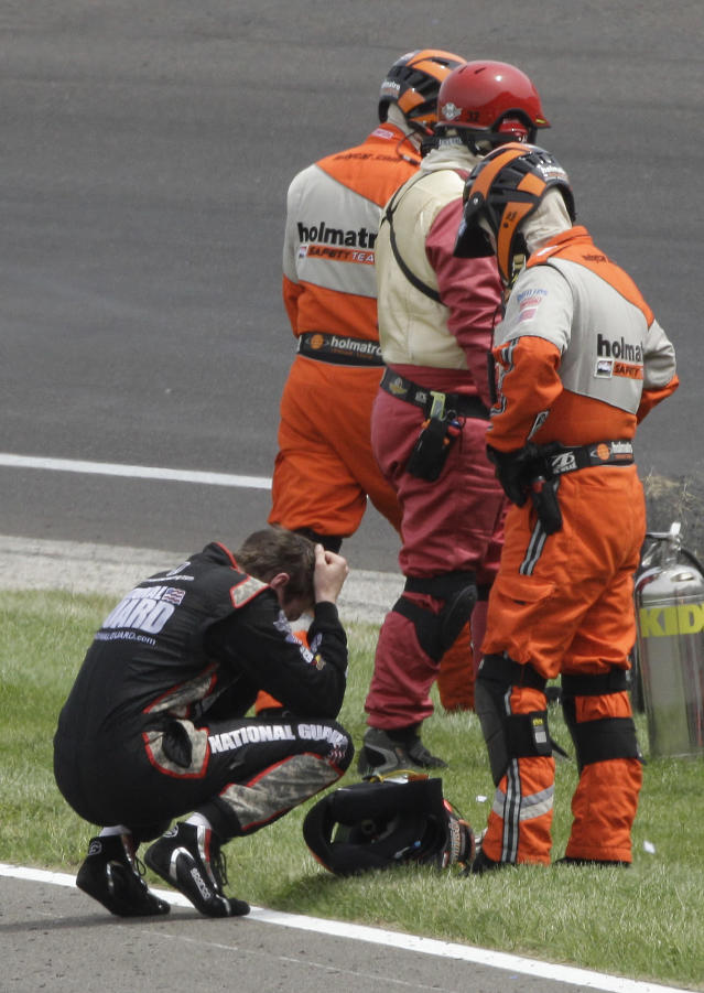 FILE - In this May 29, 2011, file photo, IndyCar driver JR Hildebrand reacts next to track safety personnel after he crashed on the final lap of the Indianapolis 500 auto race at the Indianapolis Motor Speedway in Indianapolis. Coming close in a potentially life-changing race doesn't really matter. It's how these drivers handle the situation when they return to Indy. (AP Photo/Paul Sancya, File)