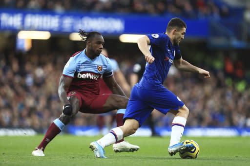 Chelsea's Mateo Kovacic, right, wins the ball from West Ham's Michail Antonio during the English Premier League soccer match between Chelsea and West Ham at Stamford Bridge Stadium in Lonodn, England, in London, England, Saturday, Nov. 30, 2019. (AP Photo/Leila Coker)
