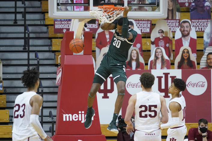 Michigan State's Marcus Bingham Jr. (30) dunks during the second half of an NCAA college basketball game against Indiana, Saturday, Feb. 20, 2021, in Bloomington, Ind. Michigan State won 78-71. (AP Photo/Darron Cummings)