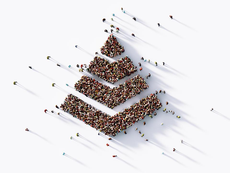 Human crowd forming a pyramid symbol on white background. Horizontal  composition with copy space. Clipping path is included. Hierarchy concept.