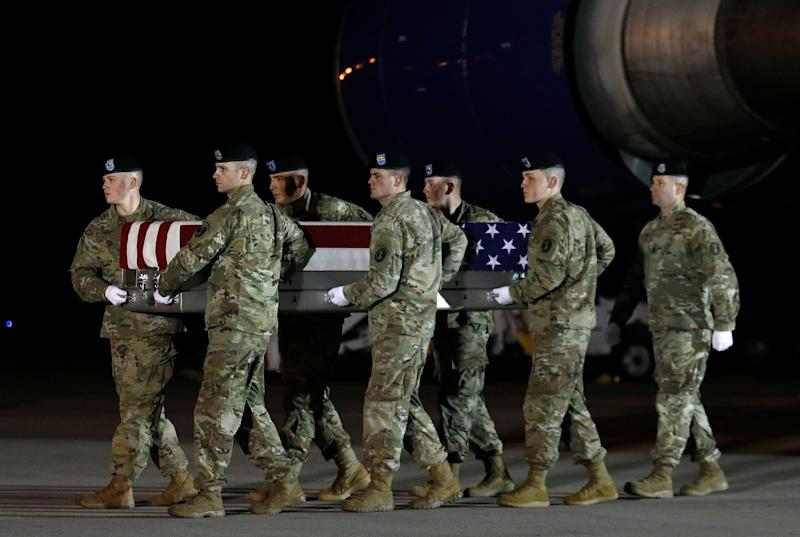 A U.S. Army carry team moves a transfer case containing the remains of Capt. Andrew P. Ross, Nov. 30, 2018, at Dover Air Force Base, Del. According to the Department of Defense, Ross, 29, of Lexington, Va., was killed Nov. 27, 2018, by a roadside bomb in Andar, Ghazni Province, Afghanistan. (Photo: Patrick Semansky/AP)