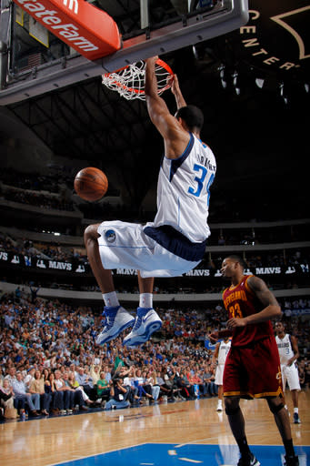 DALLAS, TX - MARCH 15: Brandan Wright #34 of the Dallas Mavericks dunks against Alonzo Gee #33 of the Cleveland Cavaliers on March 15, 2013 at the American Airlines Center in Dallas, Texas. (Photo by Glenn James/NBAE via Getty Images)