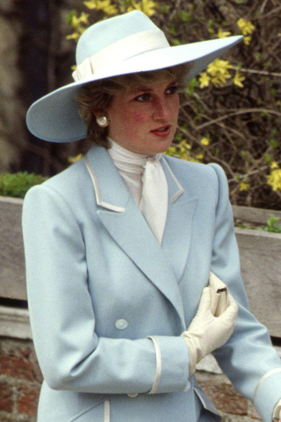 <p>In a pale blue-and-white wide-brim on her way to Easter services. </p>