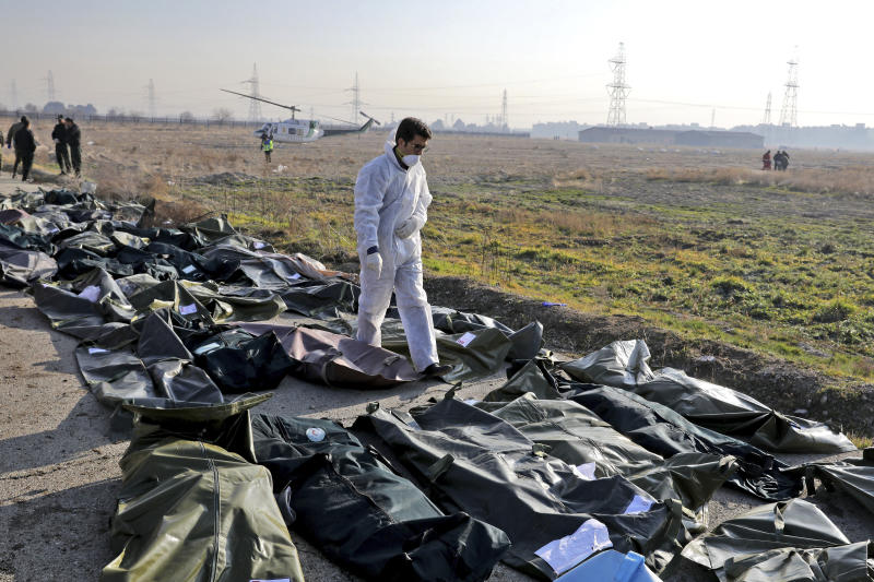 A forensic investigator works at the scene of a Ukrainian plane crash as bodies of the victims are collected, in Shahedshahr, southwest of the capital Tehran, Iran, Wednesday, Jan. 8, 2020.(Photo: Ebrahim Noroozi/AP)