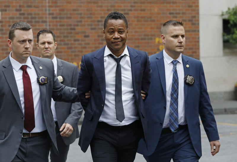 Actor Cuba Gooding Jr., center, is lead by police officers from the New York Police Department's special victims division, Thursday, June 13, 2019, in New York. Gooding Jr., 51, was arrested Thursday after turning himself in, was charged with forcible touching after a woman accused the actor of groping her at a New York City night spot. (AP Photo/Mark Lennihan)